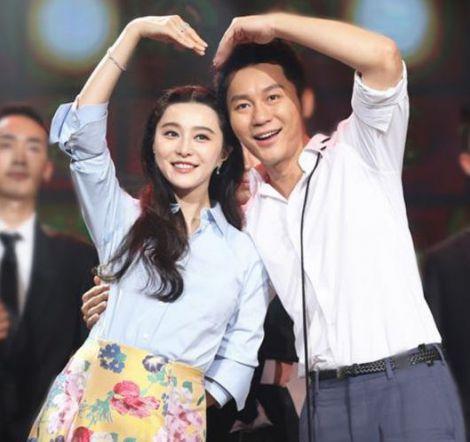 Li Chen with his fiancee Fan Bingbing.