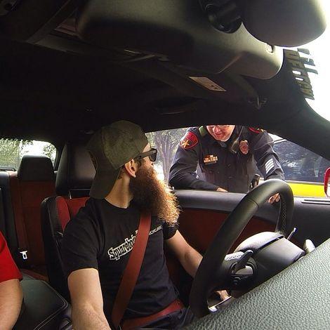 Aaron Kaufman driving his car