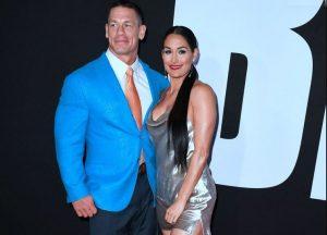 Elizabeth Huberdeau's husband, John Cena with his second wife, Nikki Bella.