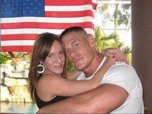 Elizabeth Huberdeau hugging her ex-husband, John Cena.