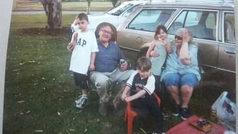 The childhood picture of Mitchell with his family