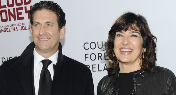 With his spouse, Christiane Amanpour