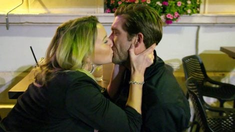 An intimate kiss of Hannah Ferrier and Adam Glick during a film scene