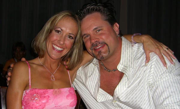 Chris Potoski with his spouse Brandi Love
