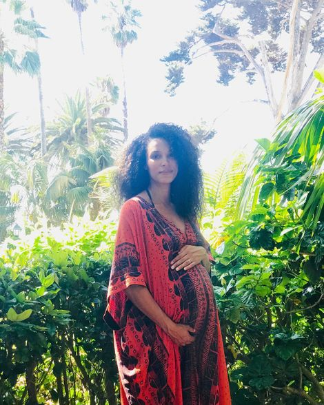 Mike McGlaflin' wife sharing a picture with a baby bump