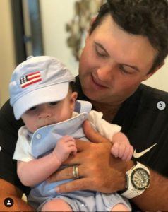 Justine Karain's second child, Barret Benjamin in the arms of Patrick Reed.