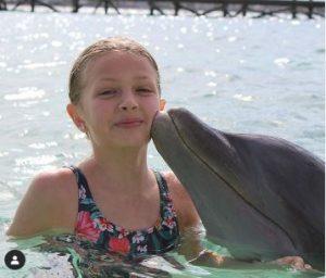 Giselle enjoying with dolphin at Baha Mar