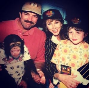 Hannah Selleck in her childhood with her parents and monkey