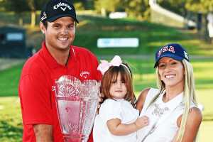 Justine Karain and Patrick Reed with their first child, Windsor-Wells.