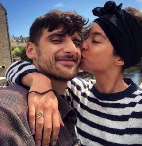 Isobel kissing on the cheek of her partner, Benjamin Zand