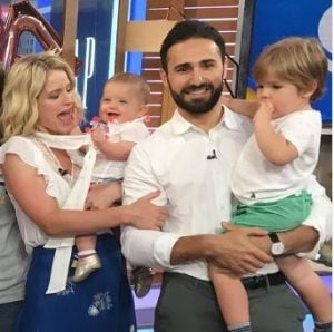 Max Shifrin and Sara Haines holding their two children
