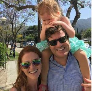 Peter Lanfer with his wife, Sarah Drew and their daughter
