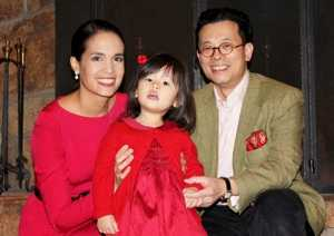Kristie Lu Stout with her husband and daughter Arabella