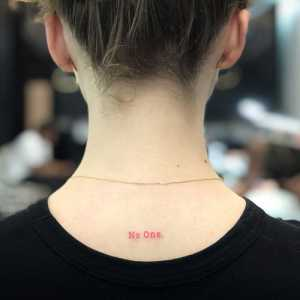 """No One"" on her neck"