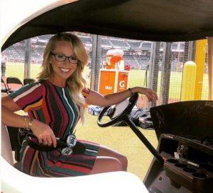 Kelsey Wingert in a Bullpen Cart