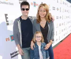 Photo of Megyn Price with her husband Edward Cotner and daughter