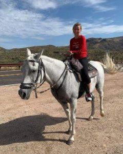 Taylor riding a horse