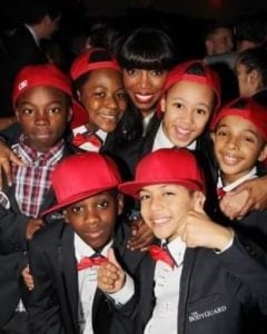Jayden Fowora with his friends and singer, Heather Headley