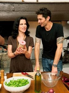 Gabriele Corcos and his wife while cooking food.