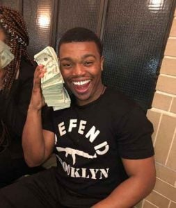 Image: Marc John Jefferies flaunting his currency