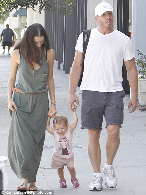 Nikki with her husband Ian and her daughter Mia