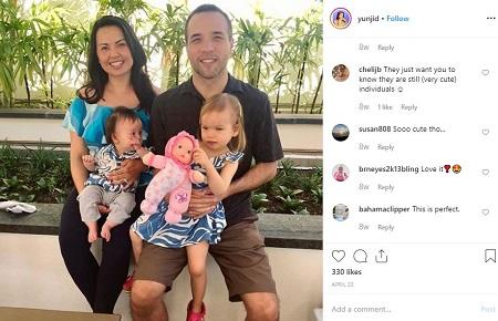 Yunji De Nies with her husband and kids