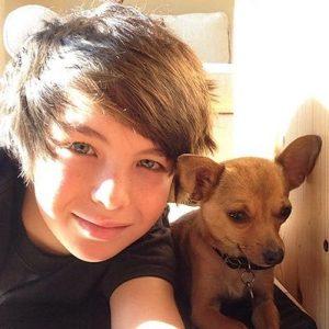 Logan Williams with his pet dog.