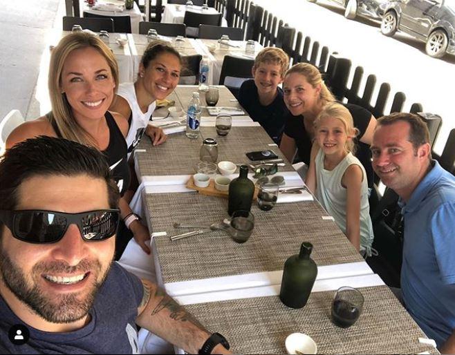 Carli Lloyd having dinner with her family in Lyon, France.