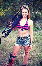 Photo of Ayla Kell with a machine gun.