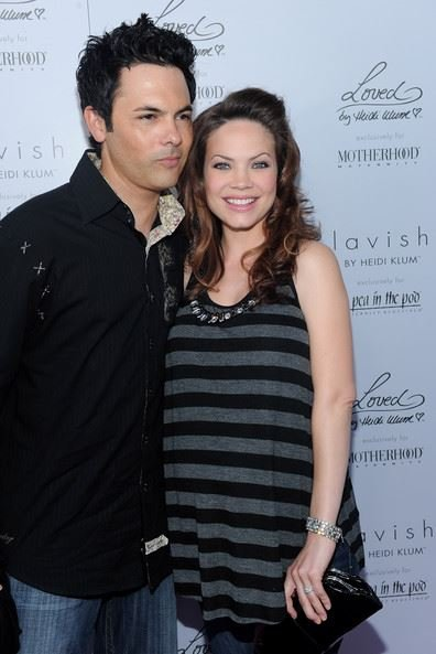 Rebecca Herbst and her husband, Michael Saucedo arrived at Heidi Klum & A Pea in the Pod's Mom's-to Be Night Out on 26th May 2010, in Beverly Hills, California.