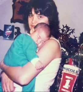 Childhood photo of Nicole Williams in her mother's arms.