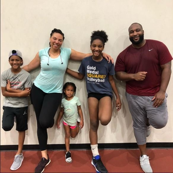 Marcus Spears with his wife and children.