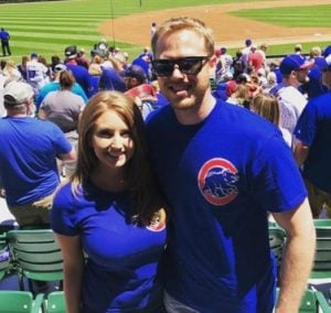Stephanie Mead with  Chad Schulz in a game field