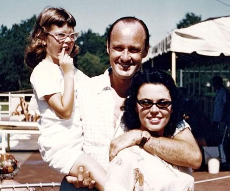 Childhood photo of Joan Celia Lee with her late parents.