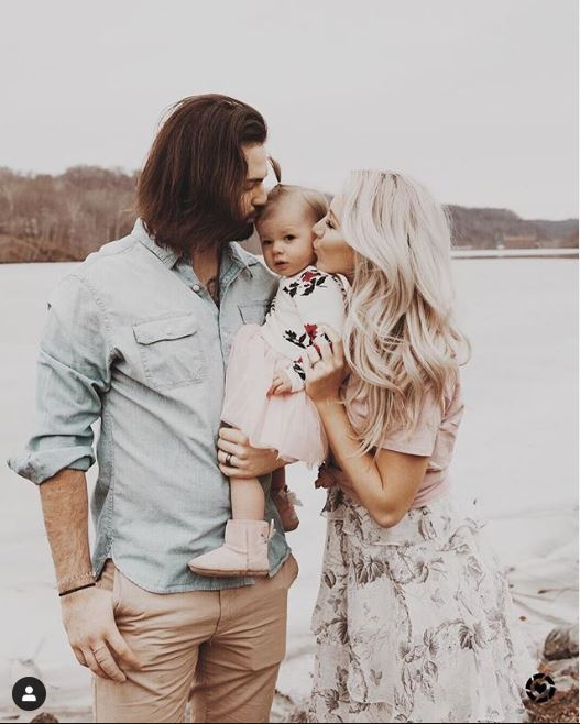 Will Grier with his wife and daughter