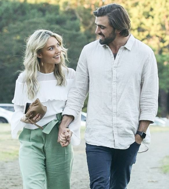 Sam Frost and her boyfriend, Dave Bashford while holding hands.