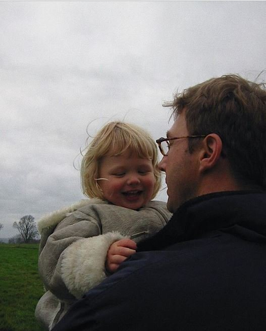 Childhood photo of Olivia Deeble with her loving father.