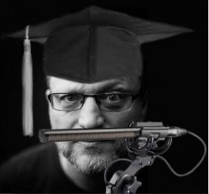Photo of Steve Blum while wearing a graduate hat.
