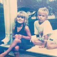 Childhood photo of Roxy Olin with her sibling, Clifford.