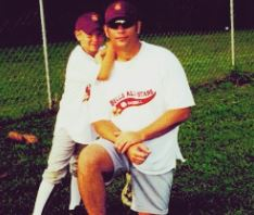 Childhood photo of Lucas Adams with his father.