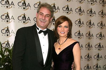 Martina McBride and her spouse John McBride,