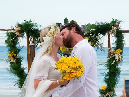 Lawrence Faulborn kissing his bride