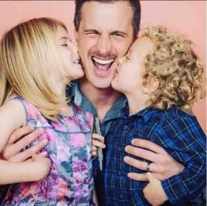 Brendan Penny sharing the love with his two beautiful children.