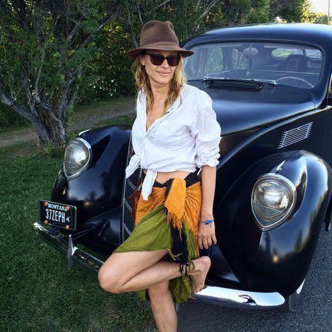 Scottie Thompson posing infront of her car