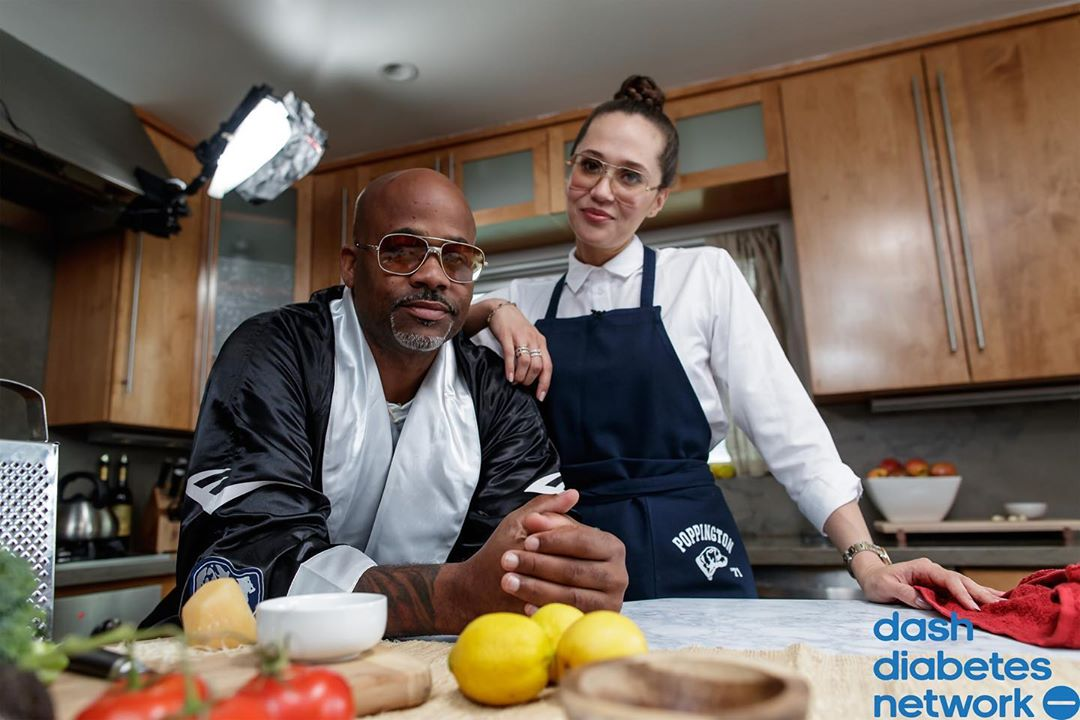 An American entrepreneur Damon Dash along with his girlfriend