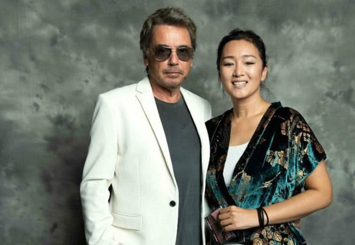 Jean-Michel Jarre with his current wife, Gong Li in a pose during the opening night of the COLCOA French Film Festival at the Directors Guild of America Theater in Los Angeles, California, on 23rd April 2018.