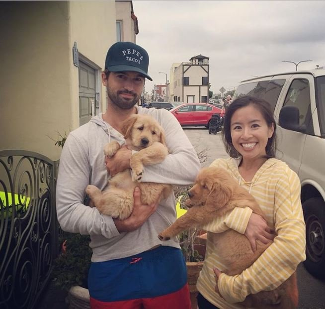 Melody Peng and her love partner, Steven Lee Busby with their pet dogs.