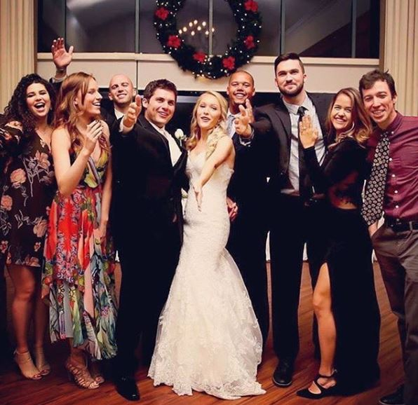 Kathryn Wahl and her husband, Hunter Parrish celebrating their wedding ceremony with their friends.