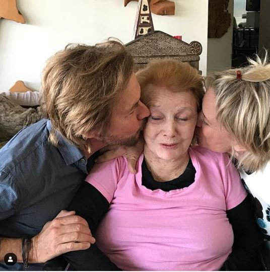 Peggy McCay's Days of Our Lives co-stars kissing her on the chicks.