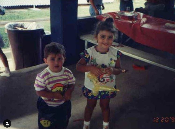 Childhood photo of Victor Arroyo with his cousin sister.